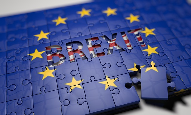 """A picture of a puzzle named """"Brexit"""" with one piece being removed."""